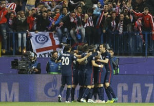 Atlético players and fans celebrate.