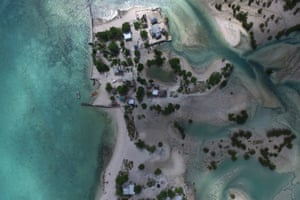 Salt water from sea incursions and storm surges have isolated some houses on the lagoon side around the village of Eita on South Tarawa. The area has become a wasteland and rendered the soil unable to sustain any crops.