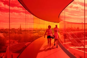 People visit the ARoS Museum of Art in Aarhus, Denmark. It recently reopened after two months of closure