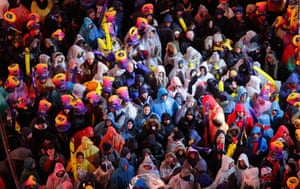 Revellers stand in the rain in Times Square on December 31.