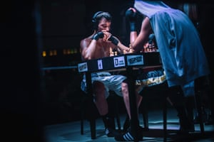 Athletes compete in a chess boxing match at the Cabaret Sauvage