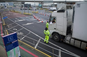 Police and port security stop cars and lorries and check their paperwork before letting them enter France at the port of Dover