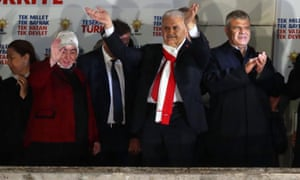 Turkish prime minister Binali Yıldırım waves at his supporters at the AKP headquarters in Ankara.