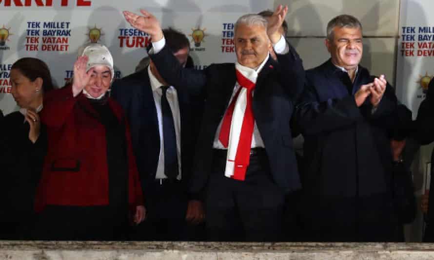 Turkish prime minister Binali Yıldırım waves at his supporters at the AKP headquarters in Ankara.