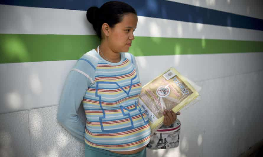 A pregnant woman holds a mosquito net. The discovery of the Zika virus in a stillborn baby girl raises concerns that the virus may cause severe damage to foetuses.