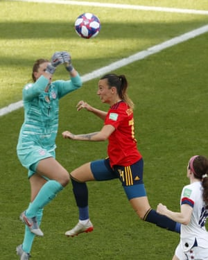 Alyssa Naeher punches clear.