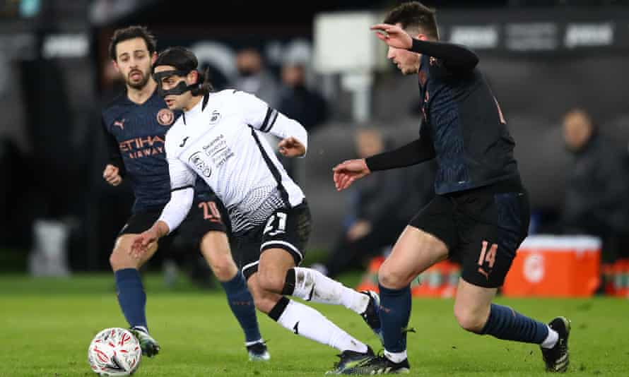 Yan Dhanda in action for Swansea against Manchester City. He was racially abused online after the game.