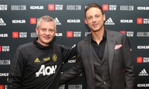 Nemanja Matic (right) with the Manchester United manager, Ole Gunnar Solskjær, after signing his new contract.