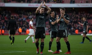 Burnley's Sam Vokes and teammates applaud the travelling fans after the final whistle.