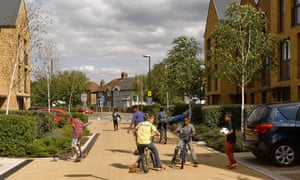 Children play on a housing estate in London.