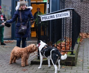 Two dogs exchange views outside a polling station in Twickenham, London