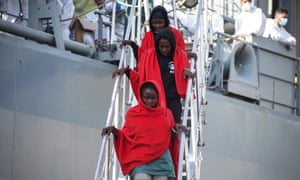 Rescued women in Salerno, Italy, disembark from the Spanish ship Cantabria on 5 November.
