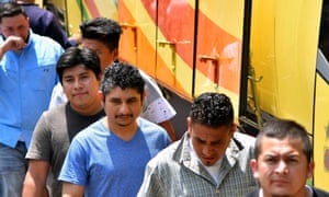 Salvadorans deported from the US arriving at the migrants' attention centre in San Salvador.