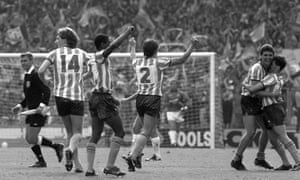 Michael Gynn and Nick Pickering (right) embrace along with jubilant teammates Graham Rodger (14), Lloyd McGrath (4) and David Phillips (2) as the Sky Blues players celebrate a famous victory.