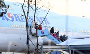 People disembark from South Korea's first evacuation plane, carrying 367 nationals, arriving from the coronavirus-hit Chinese city of Wuhan, at Gimpo International Airport.
