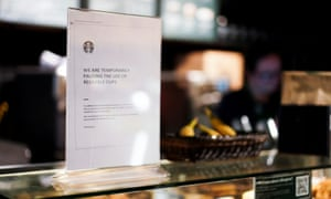 A sign explaining that drinks will not be served in reusable cups in a Starbucks in London