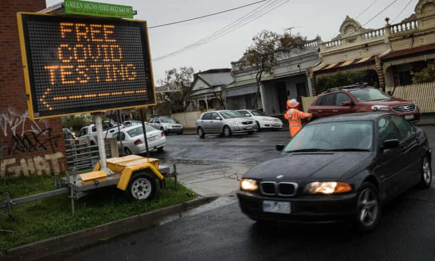 Cars enter a drive-through Covid testing site in Brunswick in Melbourne's north.