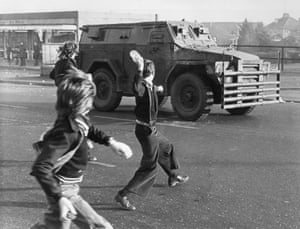belfast troubles northern ireland british army vehicle boys throwing rocks and bottles