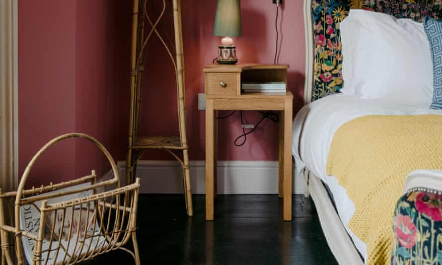 In the pink: a rhubarb bedroom with dark gloss floors.