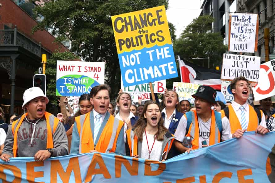 Students march through the streets during a strike to raise climate change awareness