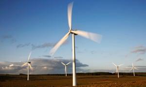 Turbines at sunset on Green Rigg Wind Farm, Northumberland.