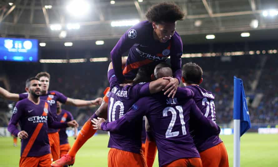 David Silva (No 21) is mobbed by Manchester City teammates after scoring a vital late winner.