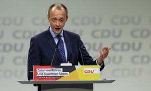 Friedrich Merz, one of the three candidates for the leadership of the CDU, delivers a speech to delegates at the party's annual conference on Friday