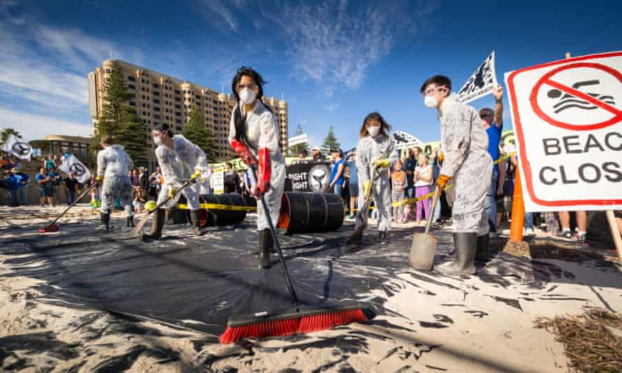 Anti-BP drilling protesters clean up a mock oil spill on the Glenelg beach.