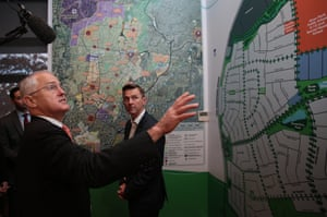 Prime Minister Malcolm Turnbull looks at the town plan drawing at Oran Park Town on June 20, 2016 in Sydney, Australia. The Turnbull Government today announced its Smart Cities policy, with plans to invest up to $100 million a year in renewable energy and energy efficient technologies.