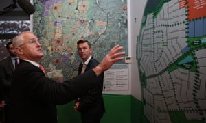 Malcolm Turnbull looks at the town plan drawing at Oran Park Town in Sydney after announcing his Smart Cities policy.