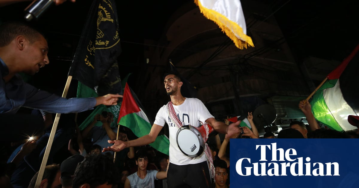 Palestinians greet ceasefire with celebrations on the streets of Gaza – video