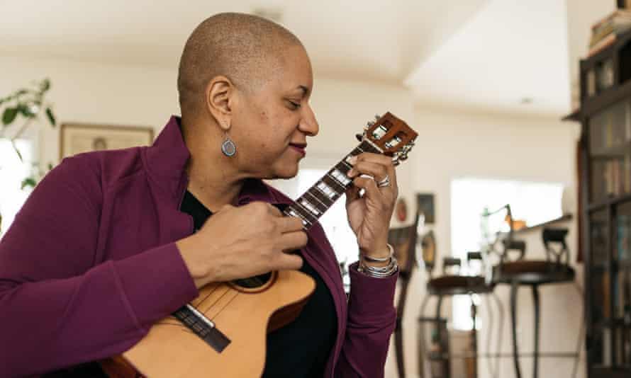 Woman playing a ukelele