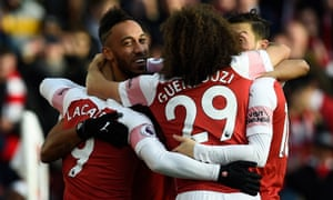 Arsenal's Pierre-Emerick Aubameyang celebrates with teammates afters scoring against Burnley.