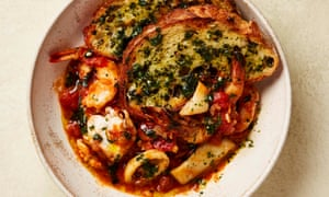 Yotam Ottolenghi's seafood stew with sourdough crust.
