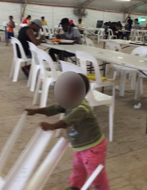 Children and adults in the mess at the detention centre