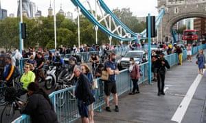 Pedestrians wait on Tower Bridge on Saturday afternoon.