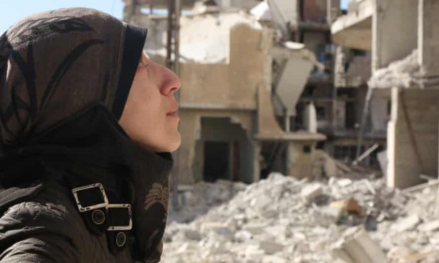 'This life is tough, but it's honest' … Amani Ballour amid the ruins of Ghouta.