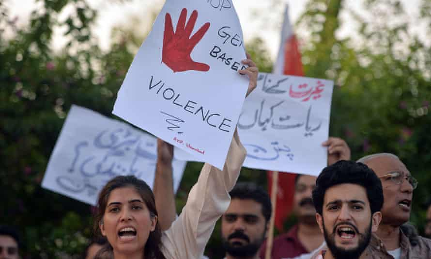 Pakistani activists carry placards during a protest in Islamabad on Monday following the murder of Qandeel Baloch