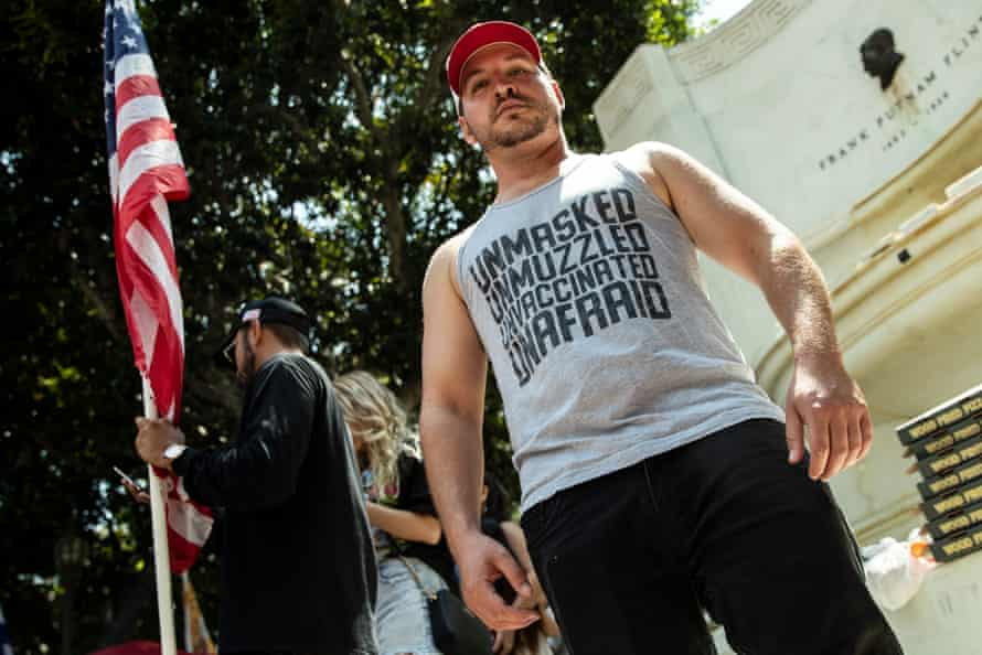 A demonstrator attends an anti-vaccine protest in front of city hall in Los Angeles on 14 August.