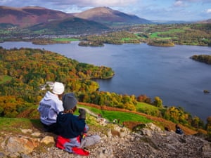 Teenage brother and sister enjoying the view over Derwent Water from Catbells