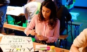 Craftivist at work: a young woman prepares for a Get Crafty for Our Climate event.