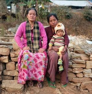 Primary school teacher Dhan Kumari Magar, 44, Krishna Thapa, 28, and her baby