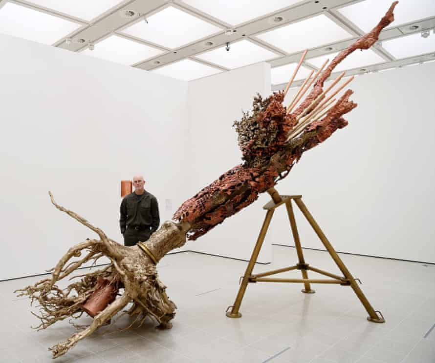 Matthew Barney with one of his sculptures, Diana..