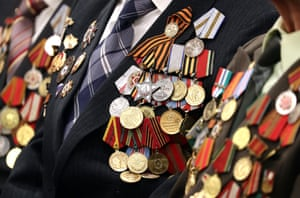 Orders and medals worn by second world war veterans during a ceremony to mark the upcoming 75th anniversary of the victory over Nazi Germany in the 1941-45 great patriotic war, the eastern front name of the second world war, at the Siberian memorial art gallery in Russia
