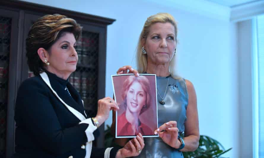 Robin and her attorney Gloria Allred hold up a photo of Robin when she was 16, at the time of the alleged assault.