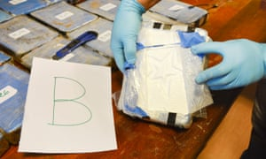 Police work during an operation that led to the seizure of hundreds of pounds of cocaine from the Russian embassy in Buenos Aires.