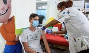 An Israeli teenager receives a vaccine against Covid-19 in Kiryat Shemona, Israel.