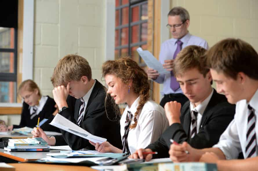 A girl reads aloud during an English A-level lesson