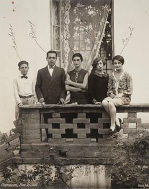 Frida Kahlo with family on balcony. From left to right: Frida's cousin Carlos Veraza, Alfonso Rouiax, Frida, Consuelo Navarro and Cristina Kahlo, in the Casa Azul on 2 November 1926