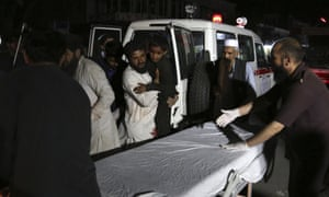 Afghan men carry an injured young boy into a hospital after a large explosion in Kabul